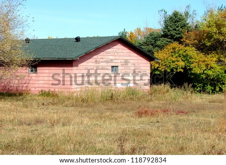 old weathered pink farm building - stock photo