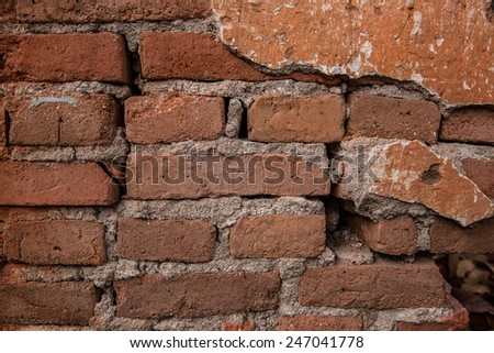 Old weathered Red brick wall fragment Background  - stock photo