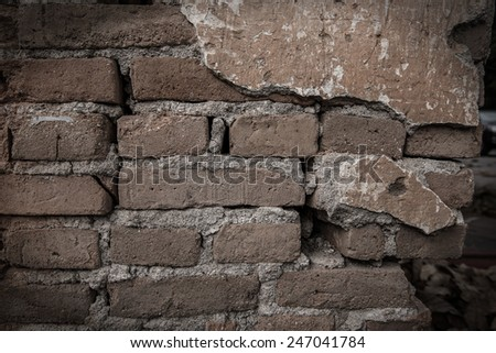 Old weathered Red brick wall fragment Background monotone - stock photo