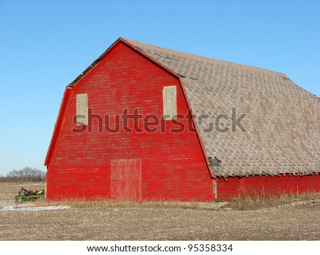 old weathered red farm building barn