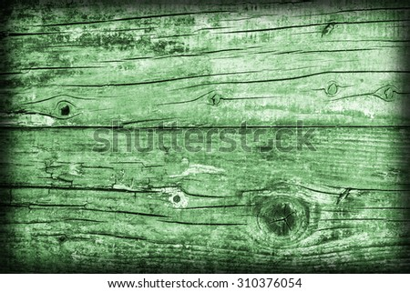 Old Weathered, Rotten, Cracked Planking, Bleached and Stained Green, Vignette Grunge Texture Detail. - stock photo
