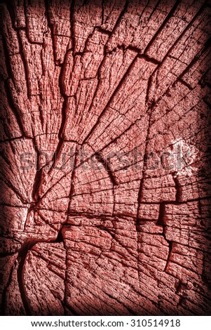 Old Weathered, Rotten, Cracked Wood, Bleached and Stained Red, Vignette Grunge Surface Texture Detail. - stock photo