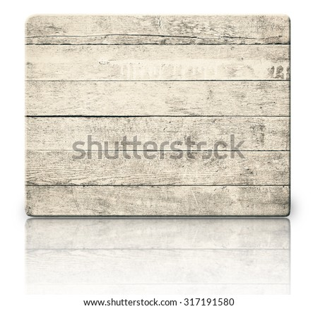 Old weathered scratched wooden signboard, planks and reflection on glass table - stock photo