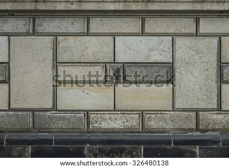 old weathered stone wall facade background or texture - stock photo