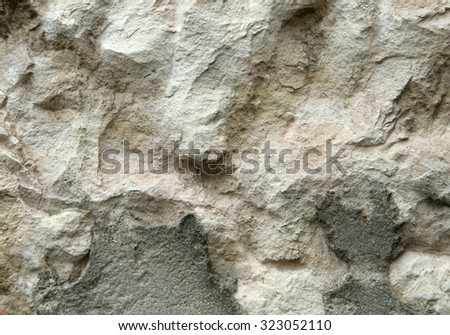 Old weathered stone wall for background or texture - stock photo