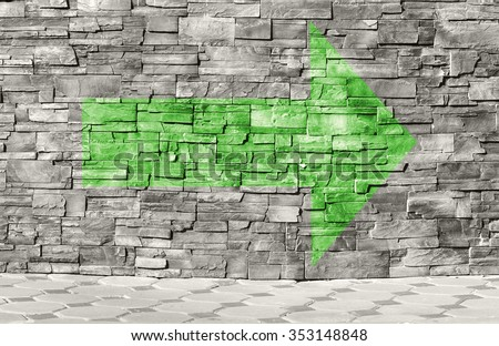 Old weathered urban wall with arrow - stock photo