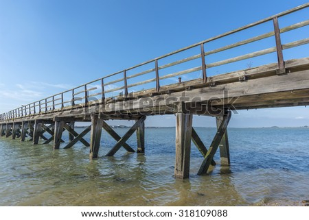 Old weathered wooden jetty on the seafront