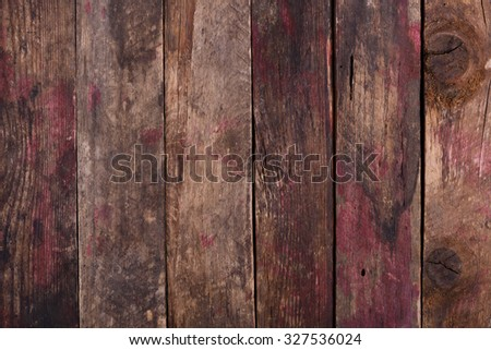 Old weathered wooden planks background with red paint marks - stock photo