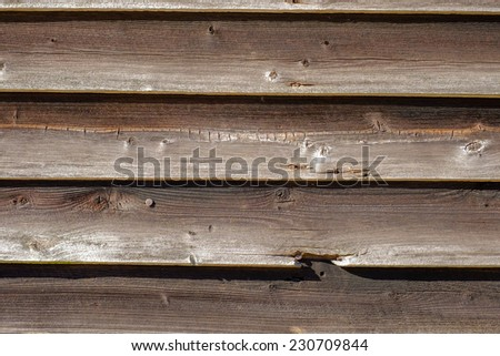 Old weathered wooden siding on the side of an old barn - stock photo
