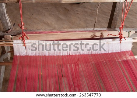 Old weaving loom and shuttle in Thailand    - stock photo