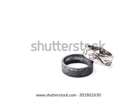 old wedding ring on the white background, metal ring