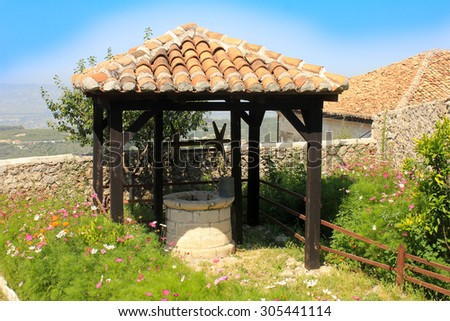 Old well in Albania - stock photo