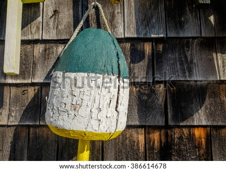 Old well used and worn out colorful lobster floats and lobster buoys found along down east Maine coast - stock photo