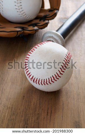 Old well used baseballs glove and bat - stock photo