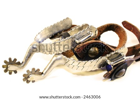 Old, well used spurs isolated on a white background. - stock photo