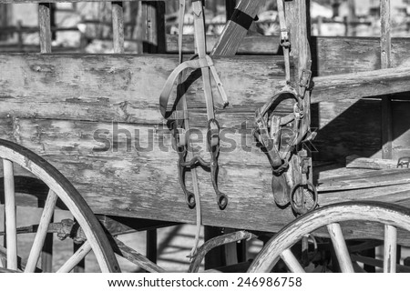 Old West background, Green buckboard wagon with Bridle in Black and White  - stock photo