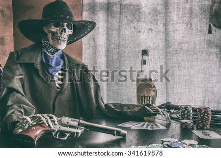 Old West Poker Skeleton Vintage. Old west bandit outlaw skeleton at a poker table with a pistol and bourbon, edited in vintage film style. - stock photo