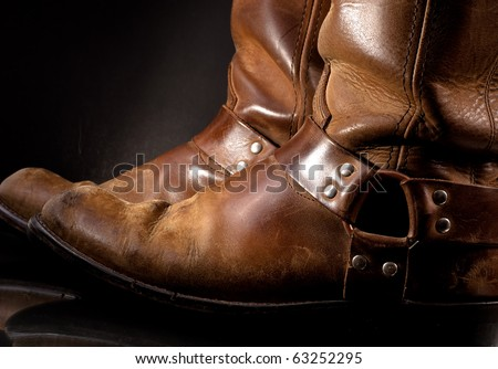 Old Western Harness Type Boots - stock photo