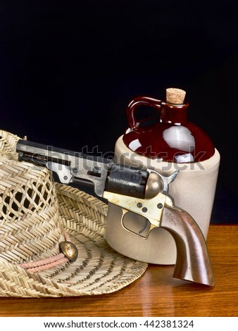Old western six shooter and jug of white lighting with room for your type. - stock photo