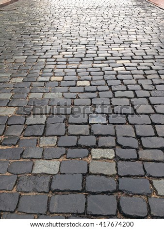 old wet granite cobblestone road as texture background