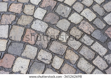 Old wet pavement with Cobblestone texture Background - stock photo