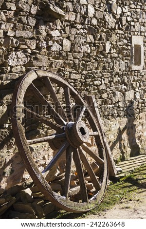 Old wheel at a farm in french village - stock photo