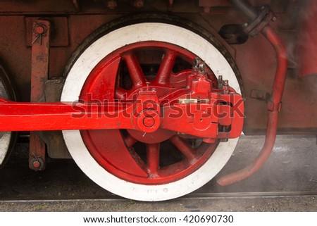 Old wheel of the locomotive - stock photo