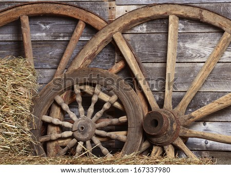 Old wheels from a cart in shed - stock photo