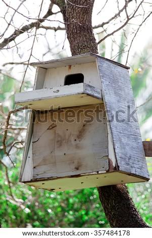 Old white bird house - stock photo