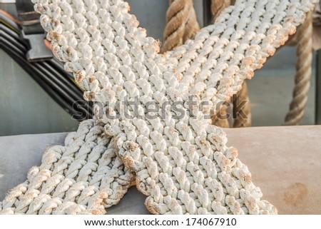 Old white braid rope - stock photo