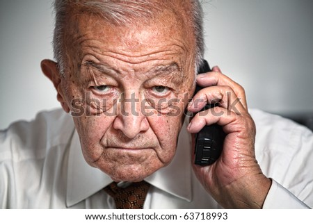 old white businessman use phone portrait - stock photo