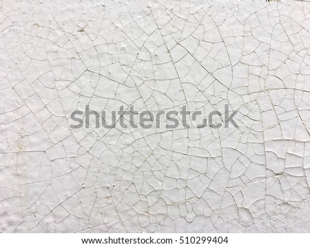 Old white concrete wall with cracked. Abstract texture background.