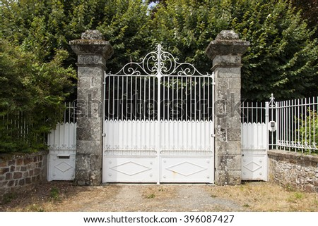 Old white double entrance made of stone and metal
