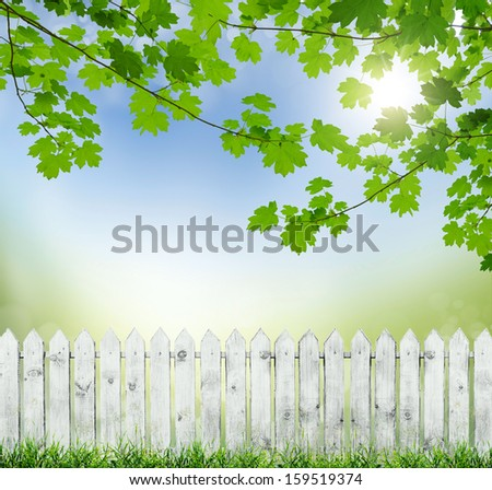 old white fence on a background of blue sky. bokeh - stock photo