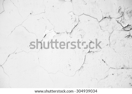Old white grunge concrete wall background with crack texture from color paint - stock photo