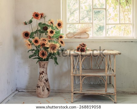 old white interior with sunflower - stock photo