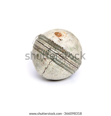 Old white leather cricket ball isolated against a white background - stock photo