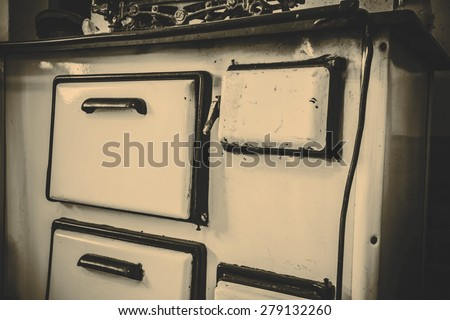 Old white metal oven in the kitchen - Czech Republic - stock photo