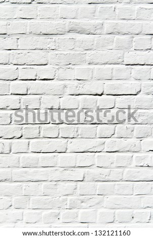 Old white painted brick wall surface - stock photo