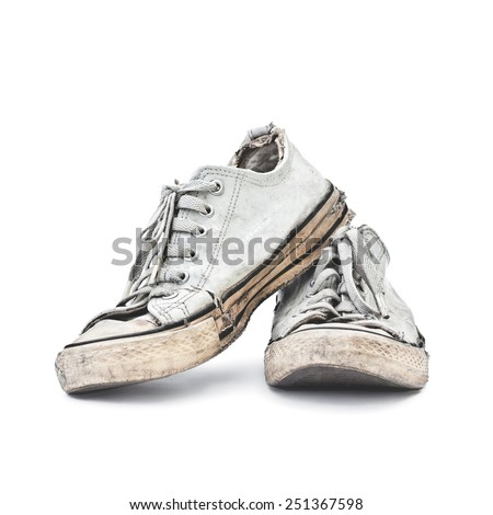 old white sneakers on white background - stock photo
