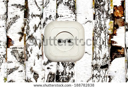 old white socket on a wooden background