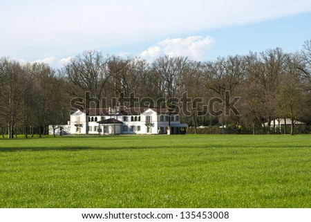 Old white villa in the Monza Park (Milan, Lombardy, Italy) at early spring