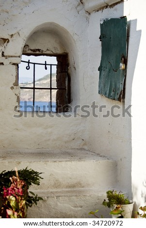 old white wall and window in Greece