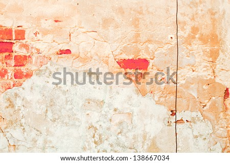 Old white wall with a vertical fracture - stock photo