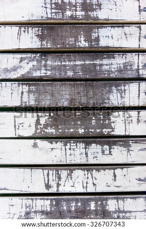 Old white weathered sharped wooden planks with copy space in the middle. Wooden  vintage background.
