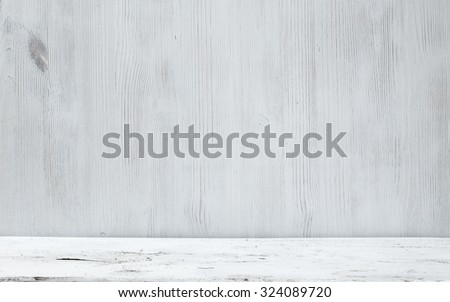 old white wooden table and gray wall - stock photo