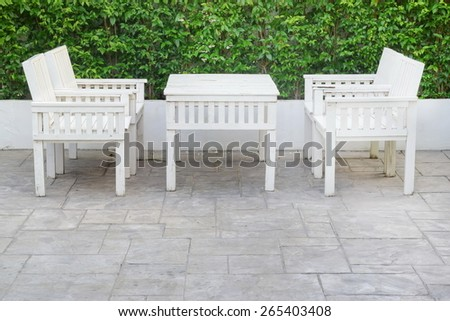 old white wooden  table set decorate in garden restaurant