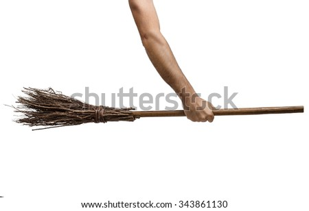 Old wicked witches broomstick being held in clenched right hand