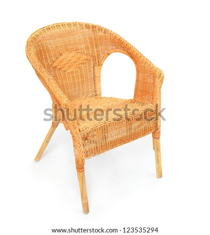 Old wicker chair on a white background. - stock photo
