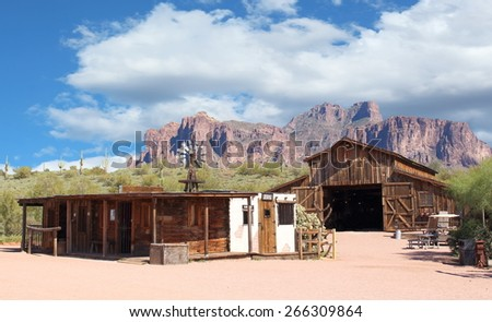 Old Wild West Cowboy Town with gold mine and jail - stock photo